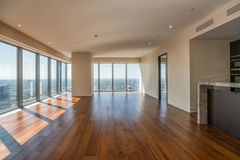 Empty  interior apartment with panoramic city view. Stock Photo