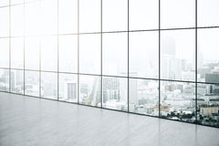Empty interior with city view. Empty interior with concrete floor and panoramic windows with city view. 3D Rendering Stock Images