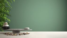 Empty interior design feng shui concept zen idea, white table or shelf with pebble balance and green bamboo, over green background royalty free stock images