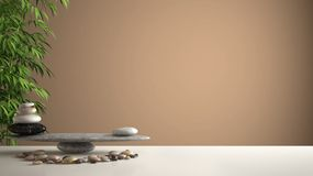 Empty interior design feng shui concept zen idea, white table or shelf with pebble balance and green bamboo, over orange backgroun. D copy space royalty free stock photography