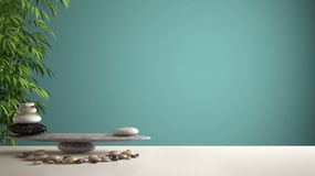 Empty interior design feng shui concept zen idea, white table or shelf with pebble balance and green bamboo, over turquoise backgr. Ound copy space royalty free stock photography