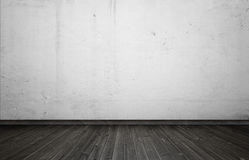 Empty interior for design, white concrete wall and black wooden floor. Royalty Free Stock Images