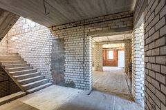 Empty interior in house without repair with white silicate brick walls stock photography
