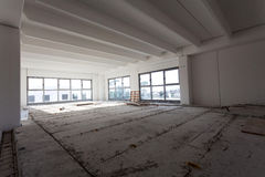 Empty interior of industrial hall. With light reflecting thru ceiling windows not finished Stock Image