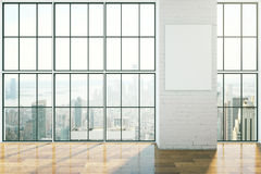 Empty interior with poster. Empty interior design with framed windows, wooden floor and blank poster on brick wall. Mock up, 3D Rendering Royalty Free Stock Photo