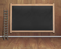 Empty interior room with ladder and black blank chalkboard Royalty Free Stock Images