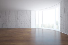 Empty interior side. Side view of empty interior with white brick walls, wooden floor and window with city view and daylight. 3D Rendering Stock Photo