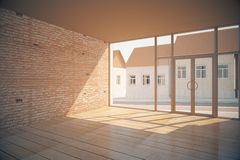 Empty interior side. Side view of empty interior with wooden floor, brick wall, glass door with street view and sunlight. 3D Rendering Royalty Free Stock Image