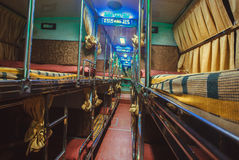 Empty interior of sleeper bus for tourists and other passengers Stock Image