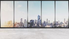 Empty interior space, concrete floor with glass wall and modern buildings in the city view Stock Photos