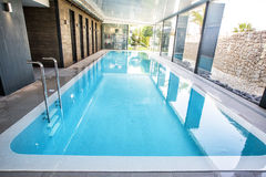 Empty interior swimming pool with relaxation area. Stock Photo