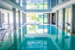 Empty interior swimming pool with relaxation area. Royalty Free Stock Images