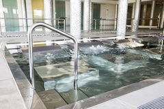 Empty interior swimming pool with relaxation area. Stock Images