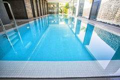 Empty interior swimming pool with relaxation area. Stock Photos