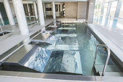 Empty interior swimming pool with relaxation area. Stock Image