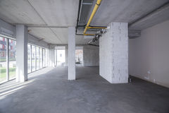 Empty interior of an unfinished building. Unfinished building interior of a new construction Royalty Free Stock Images