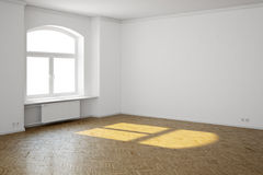 Empty interior with window. And radiator and hardwood floor Royalty Free Stock Images