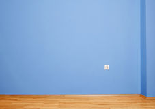 Empty interior with wooden floor and blue wall Stock Photos