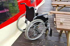 Empty invalids wheelchair in sea beach cafe Stock Photo