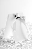Empty invite. With black and white bow. High key Royalty Free Stock Photos