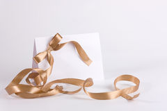 Empty invite with golden ribbon Royalty Free Stock Image