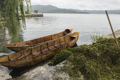 Empty iron boat with unmounted water weeds Stock Image