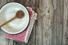 Empty iron bowl with a wooden spoon on a gray wooden surface, to Stock Photography
