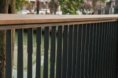Empty iron deck of house with balustrade. Empty iron deck, outdoor backyard patio in public, banister royalty free stock photography
