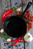 Empty iron pan. With vegetables and spices Stock Photography