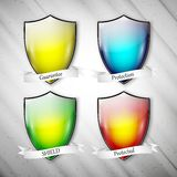 Empty isolated colored shields on dirty gray Royalty Free Stock Image