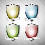 Empty isolated colored shields on dirty gray Stock Image