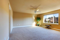 Empty ivory room with blade ceiling fan Royalty Free Stock Photo