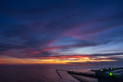 Empty jack up oil rig helipad at sunset time Royalty Free Stock Image
