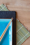 Empty Japanese sushi serving platter with chopsticks Stock Photography