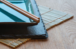 Empty Japanese sushi serving platter with chopsticks Royalty Free Stock Photos