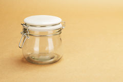 An empty jar with a closed white lid Stock Images