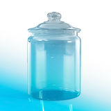Empty jar glass. Isolated on blu background Stock Photo