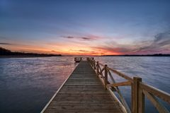 Empty jetty on lake stock photos