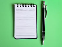 Empty jotter with pen Royalty Free Stock Photo