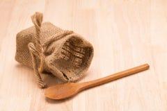 Empty jute sack on wood background. Stock Images