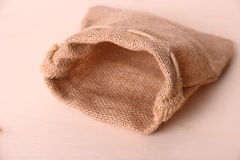 Empty jute sack on wood background Royalty Free Stock Images