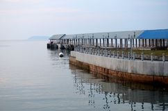 Empty kampong jetty on Tioman island Malaysia. Tioman, Malaysia - April 15, 2016: A view of the empty jetty or pier at Kampong Tekek on Tioman island Malaysia Stock Images