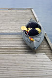 Empty kayak on wood dock Royalty Free Stock Images