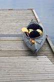 Empty kayak on wood dock Royalty Free Stock Images