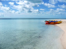 Empty kayaks on the Bahamas. Kayaks sitting on the beach in the Bahamas Royalty Free Stock Photo