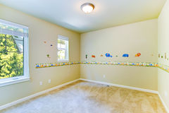 Empty kids room with painted walls Royalty Free Stock Photo