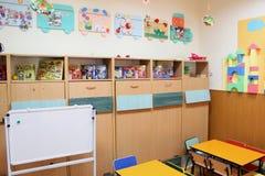 Empty kindergarten classroom. Clasroom in kindergarten with decoration and objects for preschool children Royalty Free Stock Image