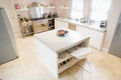 Empty kitchen. Empty white  kitchen with counter in the middle Royalty Free Stock Photos