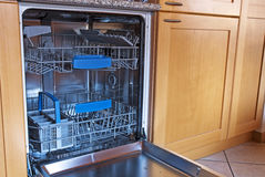 Empty kitchen dishwasher stock photo