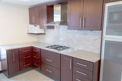 Empty kitchen in newly restored rebuilt house. Colour image kitchen in newly restored rebuilt house work surfaces Royalty Free Stock Photo